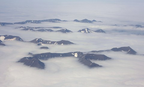 Only the upper parts of the mountains is above the arctic fog. North Iceland